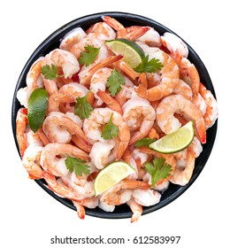 Platter of shrimps isolated, top view, with lime and cilantro.