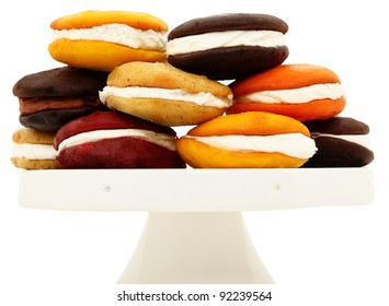 Platter Stacked With A Variety Of Whoopie Pies Isolated On White Background