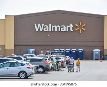 PLATTSBURGH, USA - AUGUST 23, 2017 : WalMart store and logo. Wal-Mart Stores Inc. doing business as Walmart, is an American multinational retailing corporation that operates as a chain of hypermarkets