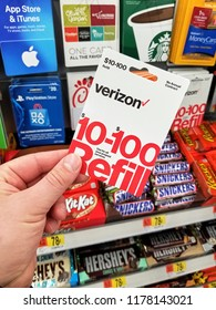 PLATTSBURGH, USA - SEPTEMBER 10, 2018: A man holding a Verizon gift card. Verizon is an American telecommunications company which offers wireless services and products