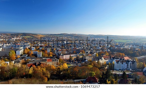 Plauen city with nice landscape with small hills, meadows and colorful forest around from view tower on Barenstein hill in Vogtland region in Saxony (Germany) during nice autumn day with clear sky