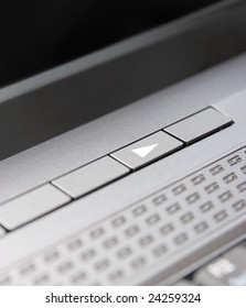 Play button on laptop keyboard. Closeup.