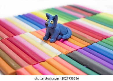 Play clay abstraction. Cat on colored background.