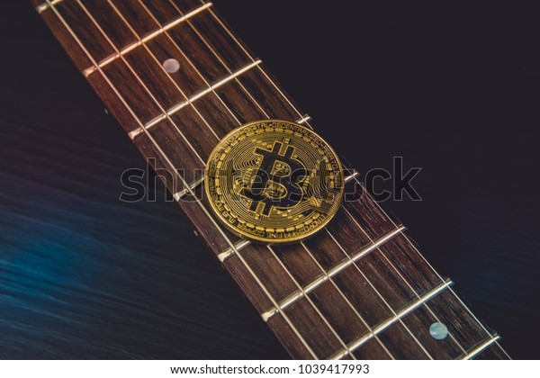 Play for cryptocurrency with guitar and bitcoin.