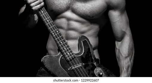 Play the guitar. Torso man. Chest muscles, Six pack, ab, triceps. Electric guitar. Music festival. Instrument on stage and band. Strong, muscular, muscles man, bodybuilding. Music concept.