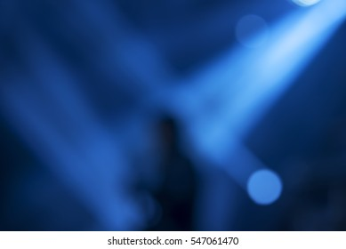 Play with the light beautiful backgrounds with a silhouette of guitarist