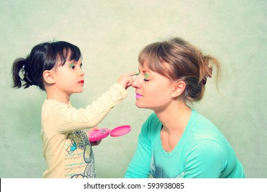 play makeup. Mom and daughter. happy childhood