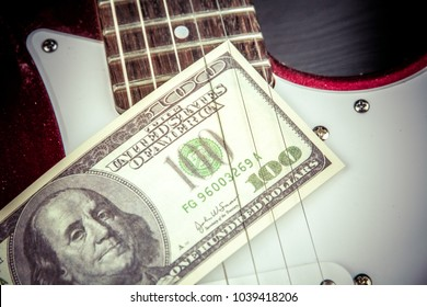 Play for money with guitar and cash.Music and money concept.