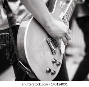 play on guitar, selective focus on part of hand and strings