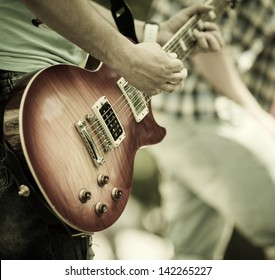 play on guitar, selective focus on part of strings