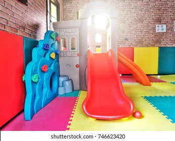 Play room with colorful slider.
