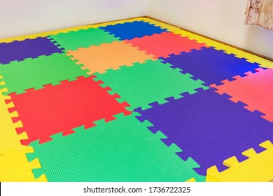 Play room for young children with colorful mat