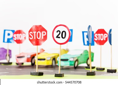 Play set of toy speed-limit and stop road signs