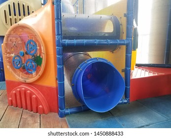 play structure with netting and blue plastic slide