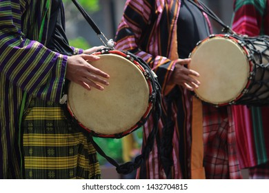 Play traditional drum instruments from Central Java, Indonesia