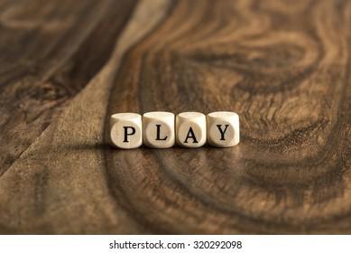 PLAY word background on wood blocks