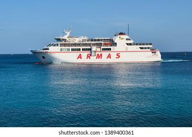 Playa Blanca, Lanzarote, Spain: April 28, 2019: Canary Islands ferry Armas sails between Playa Blanca Lanzarote and Corralejo Fuerteventura.