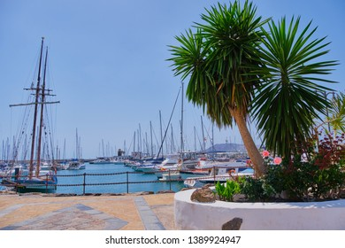 Playa Blanca, Lanzarote, Spain - April 29, 2019: yacht boats mooring in Rubicon port of Playa Blanca. Canary Islands are very popular holiday destination due to sunny tropical climate all year round.