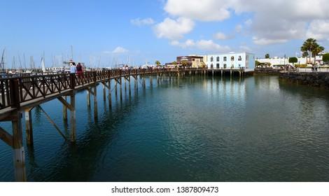 PLAYA BLANCA, LANZAROTE, SPAIN - MARCH 27, 2017: Boardwalk at Marina Rubicon port at Playa Blanca in Canary Islands