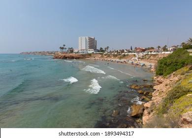 Playa Cala Cerrada Orihuela Spain beautiful small beach near La Zenia in summer sunshine