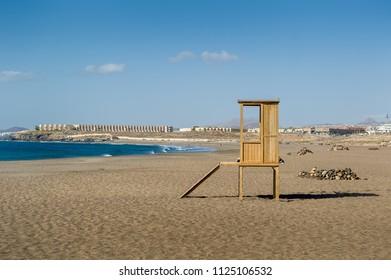 Playa de Tejita sand beach and wooden lifeguard post. Tenerife island. Canary islands, Spain.