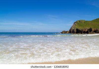 Playa de Torimbia, one of the best nudist beaches in Asturias, Spain