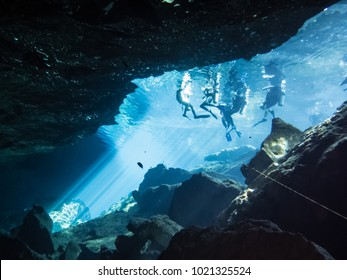 Playa del Carmen, Mexico - febraury 2017 . Group of divers on the surface at the cenote Chac Mool