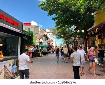 Playa del Carmen, Mexico - February 7, 2019: Tourists walks and have fun in the city center of Playa del Carmen in Quintana Roo.
