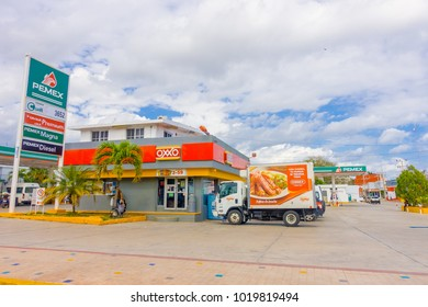 Playa del Carmen, Mexico - January 10, 2018: Outdoor view of many cars parked in a gas station in playa del Carmen Mexico