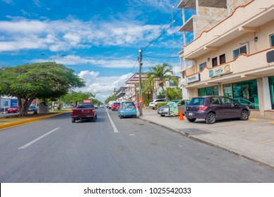 Playa del Carmen, Mexico - January 10, 2018: Outdoor view of some cars parked on 5th Avenue, the main street of the city. The city boasts a wide array of tourist activities due to its geographical
