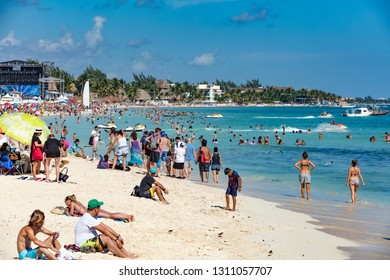 Playa del Carmen, Mexico - January 7 2016 - The public beach of Playa del Carmen in Mexico. The city boasts a wide array of tourist activities due to its geographical location in the Riviera Maya.
