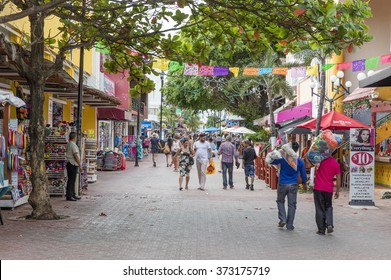 Playa del Carmen, Mexico - January 4 2016 - People on 5th Avenue, the main street of the city. The city boasts a wide array of tourist activities due to its geographical location in the Riviera Maya.