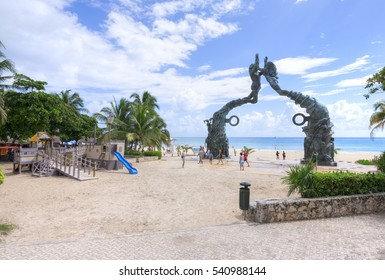PLAYA DEL CARMEN, MEXICO - NOVEMBER 8, 2016: A playground for children in front of the Mayan monument on the beach makes Playa del Carmen a family-friendly Mexican Riviera travel destination.