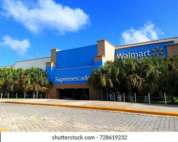 PLAYA DEL CARMEN, MEXICO – OCTOBER 5, 2017: Front view of Walmart Supermarket / Supermercado with palm trees in Playa del Carmen, Mexico