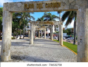 PLAYA DEL CARMEN, MEXICO - OCTOBER 15, 2017: Decorative columns with sings Playa del Carmen, Puerto Aventuras, Akumal, Chetumal, Tulum and other towns from Riviera Maya, Mexico