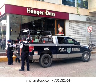 PLAYA DEL CARMEN, MEXICO - OCTOBER 15, 2017: Police of Policia Municipal on street in center of Playa del Carmen, Mexican city known for high drug-related crime rate