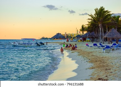 PLAYA DEL CARMEN, MEXICO-MAY 20: A beautiful all inclusive resort beach scene at twilight on May 20 2015 in Playa Del Carmen Mexico.