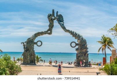 PLAYA DEL CARMEN, QUINTANA ROO, MEXICO - MAY 6, 2017 - Tourists Visiting Portal Maya - Oceanfront Bronze Statue