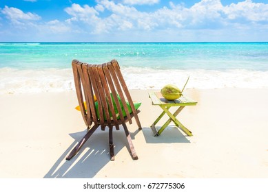 Playa del Carmen - relaxing on chair at paradise beach and city at caribbean coast of Quintana Roo, Mexico