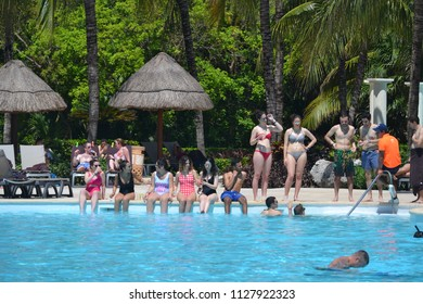 Playa del Carmen/Mexico- 04/28/2018: Young adults lounge by the pool at a tropical resort during Spring Break.