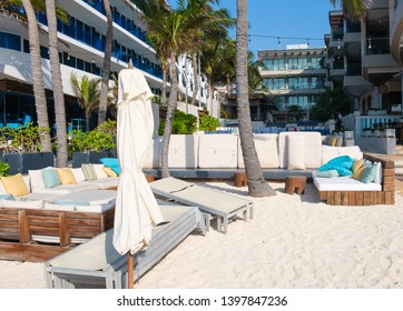 PLAYA DEL CARMEN,MEXICO - APRIL 19,2019 : Beach Club by the seaside at the touristic city of Playa del Carmen on the Mayan Riviera