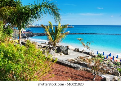 Playa Dorada beach in Playa Blanca, southern part of Lanzarote, view of sandy beach and turquoise se, Canary islands, Spain, selective focus