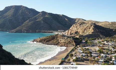 Playa El Portus Nudist Beach with Mountain and Ocean Landscape in Cartagena near Murcia, Spain.