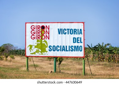 PLAYA GIRON, CUBA - APRIL 27: Sign with test meaning 'Victory of socialism' on the road to Playa Giron, best known as the famous Bay of pigs, on April 27, 2016 in Cuba