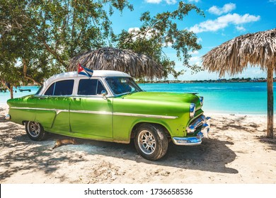 Playa La Herradura, Cuba - October 27, 2019: American classic car on the beach Playa La Herradura, Province Las Tunas, Cuba