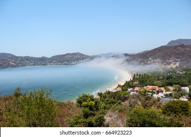 Playa La Ropa with fog rolling in, Zihuatanejo Mexico