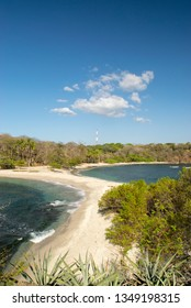 Playa San Juanillo in Guanacaste Costa Rica on the Pacific Coast where two bays come together leaving a narrow, sandy beach between them