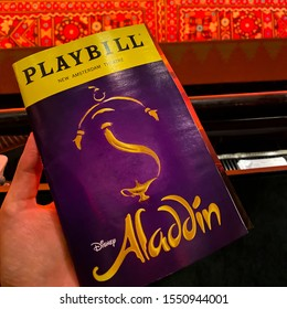 Playbill featuring Aladdin broadway show held by a customer while waiting for the Disney's Aladdin show at the New Amsterdam Theater. Manhattan, New York November 2, 2019.