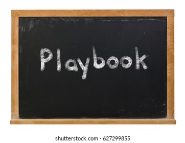 Playbook written in white chalk on a black chalkboard isolated on white