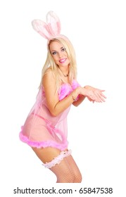 Playboy girl in a rose baby-doll and rabbit ears is posing